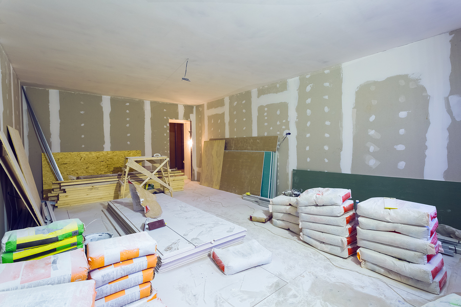 Materials for constraction (putty packs, sheets of plasterboard or drywall)  in apartment is under construction, remodeling, renovation, extension, restoration and reconstruction.